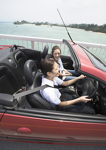 Two women driving a convertible